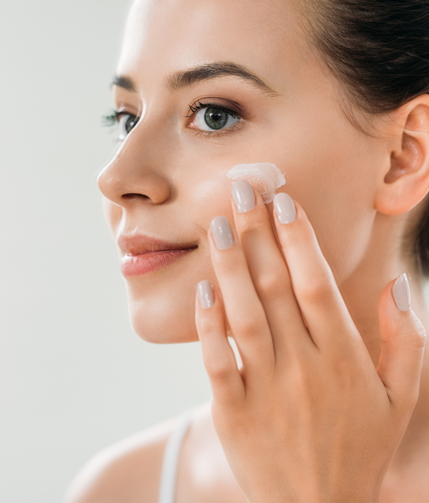 Woman using skincare products on her face