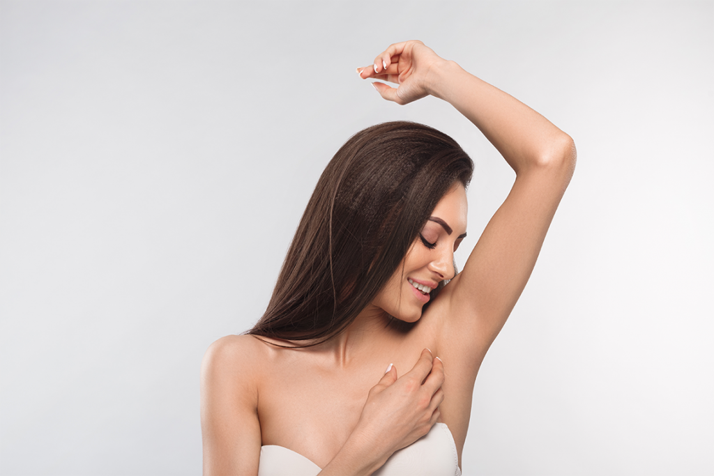 Woman touching her hairless armpit